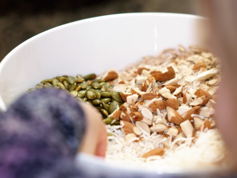 mixing-honey-almond-coconut-granola
