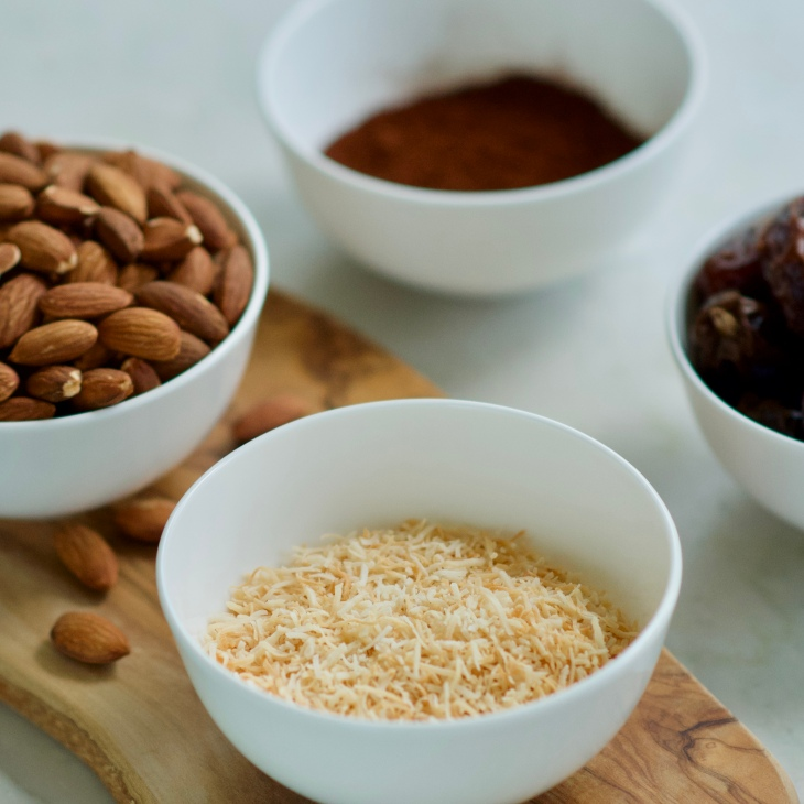 Ingredients for date almond bars, dates, almonds, coconut and cocoa powder