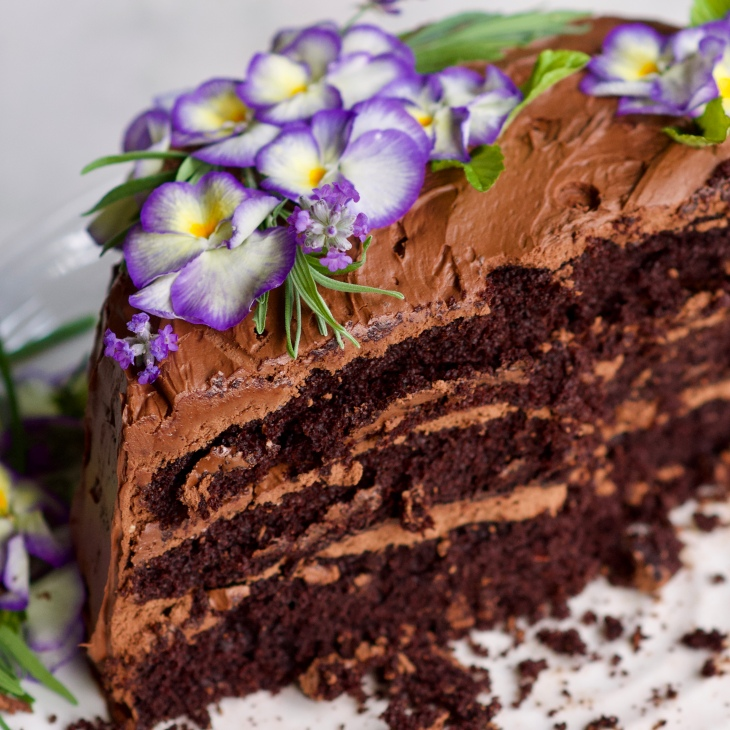 rebar chocolate cake with edible flowers cut in half